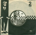 "I Can't Stand Up For Falling Down UK 7"" Two Tone single front sleeve.jpg"